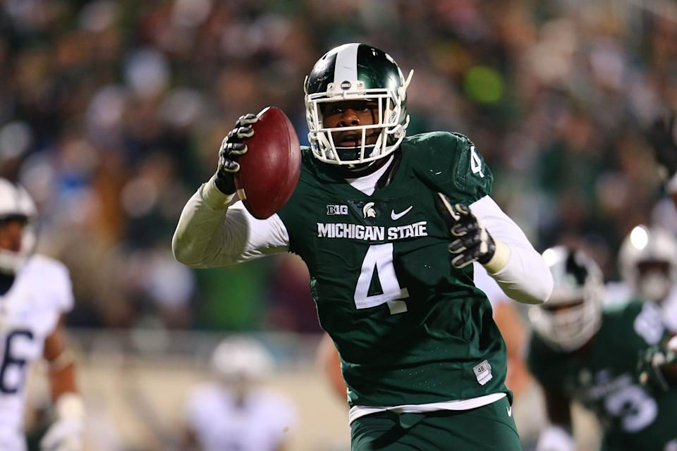 EAST LANSING, MI - NOVEMBER 28: Malik McDowell #4 of the Michigan State Spartans intercepts a pass and returns it for the touchdown in the fourth quarter against the Penn State Nittany Lions at Spartan Stadium  on November 28, 2015 in East Lansing, Michigan. (Photo by Rey Del Rio/Getty Images)