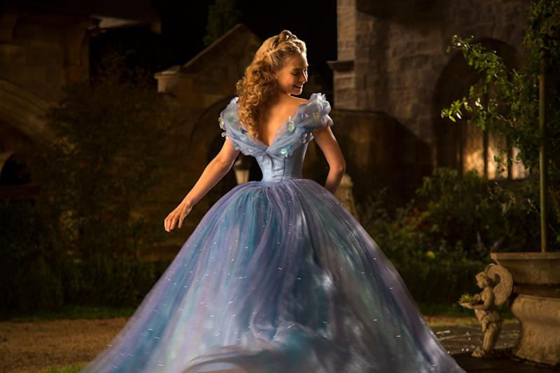 Lily James wears a spiffy ball gown as the title character of