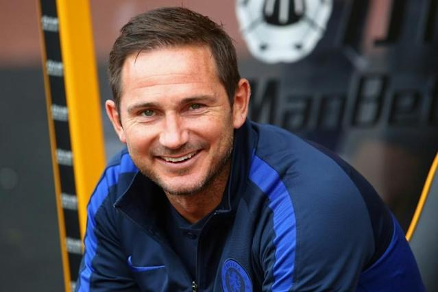 All smiles: Frank Lampard's Chelsea enjoyed a 5-2 win at Wolves on Saturday (AFP Photo/GEOFF CADDICK)