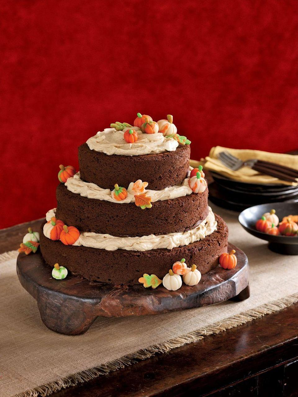 """<p>Decorate this triple-layered pumpkin cake with edible pumpkin candies for a cute dessert that the kids will love even more than their Halloween haul.</p><p><em><a href=""""https://www.womansday.com/food-recipes/food-drinks/recipes/a13686/pumpkin-spice-cake-3559/"""" rel=""""nofollow noopener"""" target=""""_blank"""" data-ylk=""""slk:Get the recipe from Woman's Day »"""" class=""""link rapid-noclick-resp"""">Get the recipe from Woman's Day »</a></em></p>"""