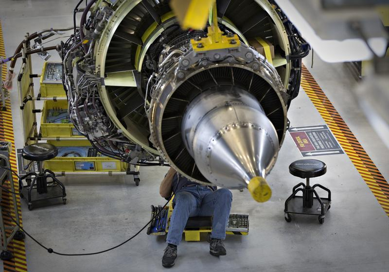 A worker carries out the final preparations on an engine for the Boeing 737-900 at their assembly operations in Renton