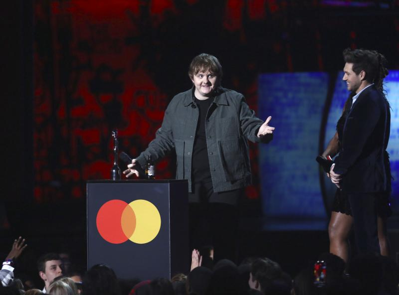 Lewis Capaldi accepts his award for New Artist of the Year on stage at the Brit Awards 2020 in London, Tuesday, Feb. 18, 2020. (Photo by Joel C Ryan/Invision/AP)