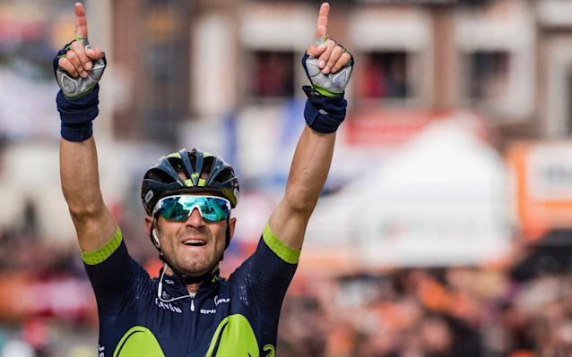 Alejandro Valverde celebrates winning his fourth Liège-Bastogne-Liège title to become the race's second most successful rider after Eddy Merckx who has won it five times - AP