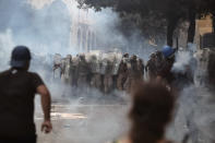 Lebanese soldiers stand among tear gas during clashes with protesters as part of a protest against the political elites and the government after this week's deadly explosion at Beirut port which devastated large parts of the capital in Beirut, Lebanon, Saturday, Aug. 8, 2020. (AP Photo/Thibault Camus)