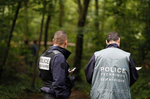 Police investigate in the Vincennes forest after the torsos were found