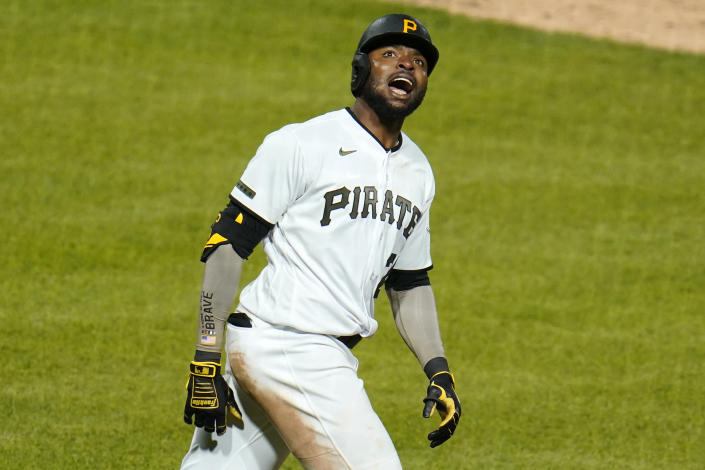 Pittsburgh Pirates' Gregory Polanco celebrates as he runs to first base after driving in the winning run with a sacrifice fly off San Francisco Giants relief pitcher Caleb Baragar during the 11th inning of a baseball game in Pittsburgh, Friday, May 14, 2021. The Pirates won 3-2. (AP Photo/Gene J. Puskar)