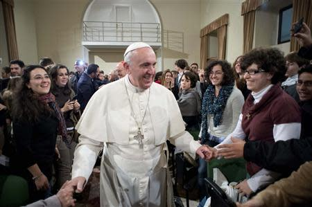Pope Francis is greeted during a pastoral visit at the Sacro Cuore Basilica in downtown Rome