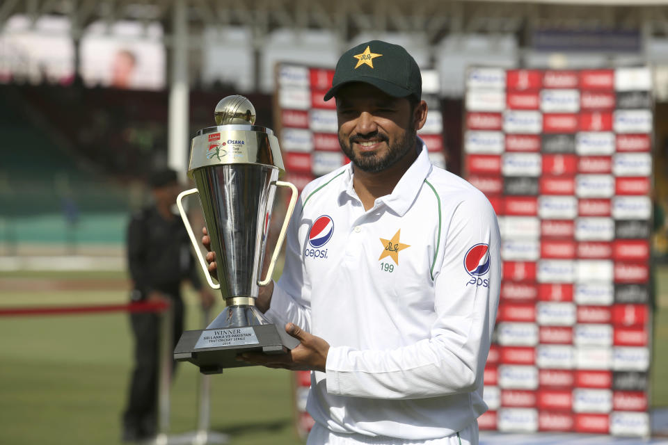 Pakistani captain Azhar Ali holds a trophy to celebrate the victory against Sri Lanka in the second test in Karachi, Pakistan, Monday, Dec. 23, 2019. Pakistan completed a winning comeback to tests on home soil with a 1-0 series victory over Sri Lanka on Monday. (AP Photo/Fareed Khan)