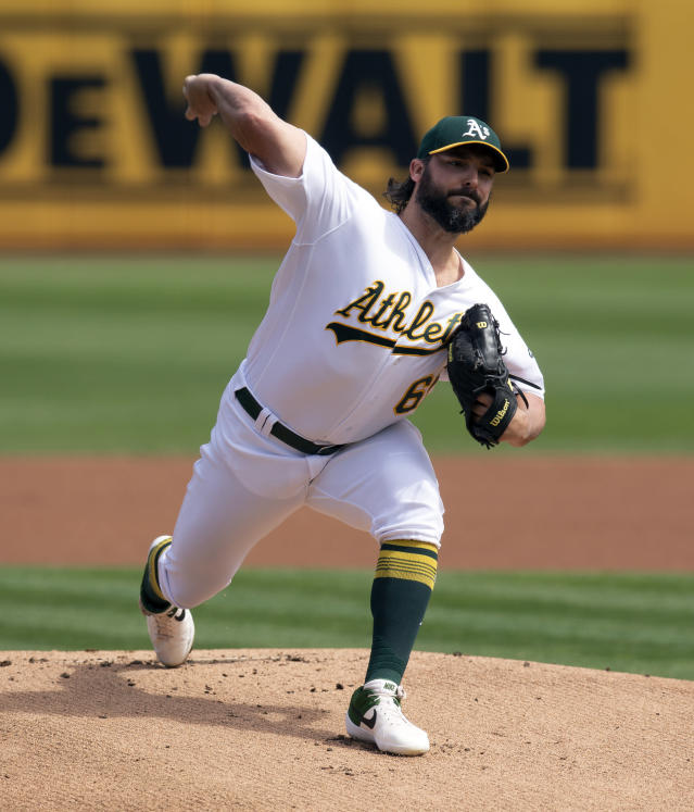 Oakland Athletics starting pitcher Tanner Roark (60) delivers against the Texas Rangers during the first inning of a baseball game Sunday, Sept. 22, 2019, in Oakland, Calif. (AP Photo/D. Ross Cameron)