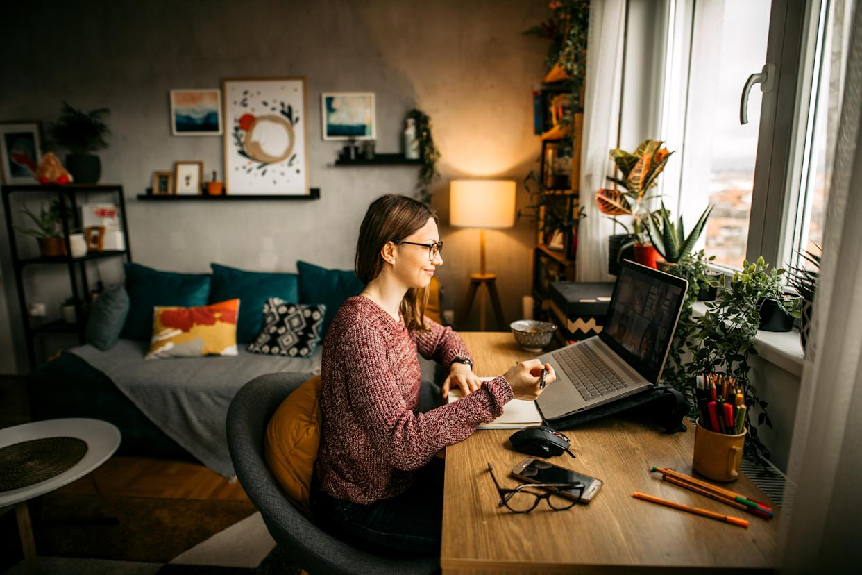 Young woman working from home office and having video conference.