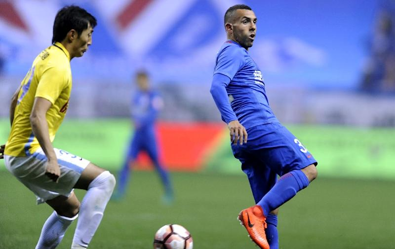Shanghai Shenhua's Argentine striker Carlos Tevez (R) is in hot water after being spotted at Disneyland after missing a game with his Chinese club