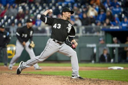 Mar 31, 2018; Kansas City, MO, USA; Chicago White Sox pitcher Danny Farquhar (43) throws a pitch against the Kansas City Royals in the eighth inning at Kauffman Stadium. Mandatory Credit: Amy Kontras-USA TODAY Sports