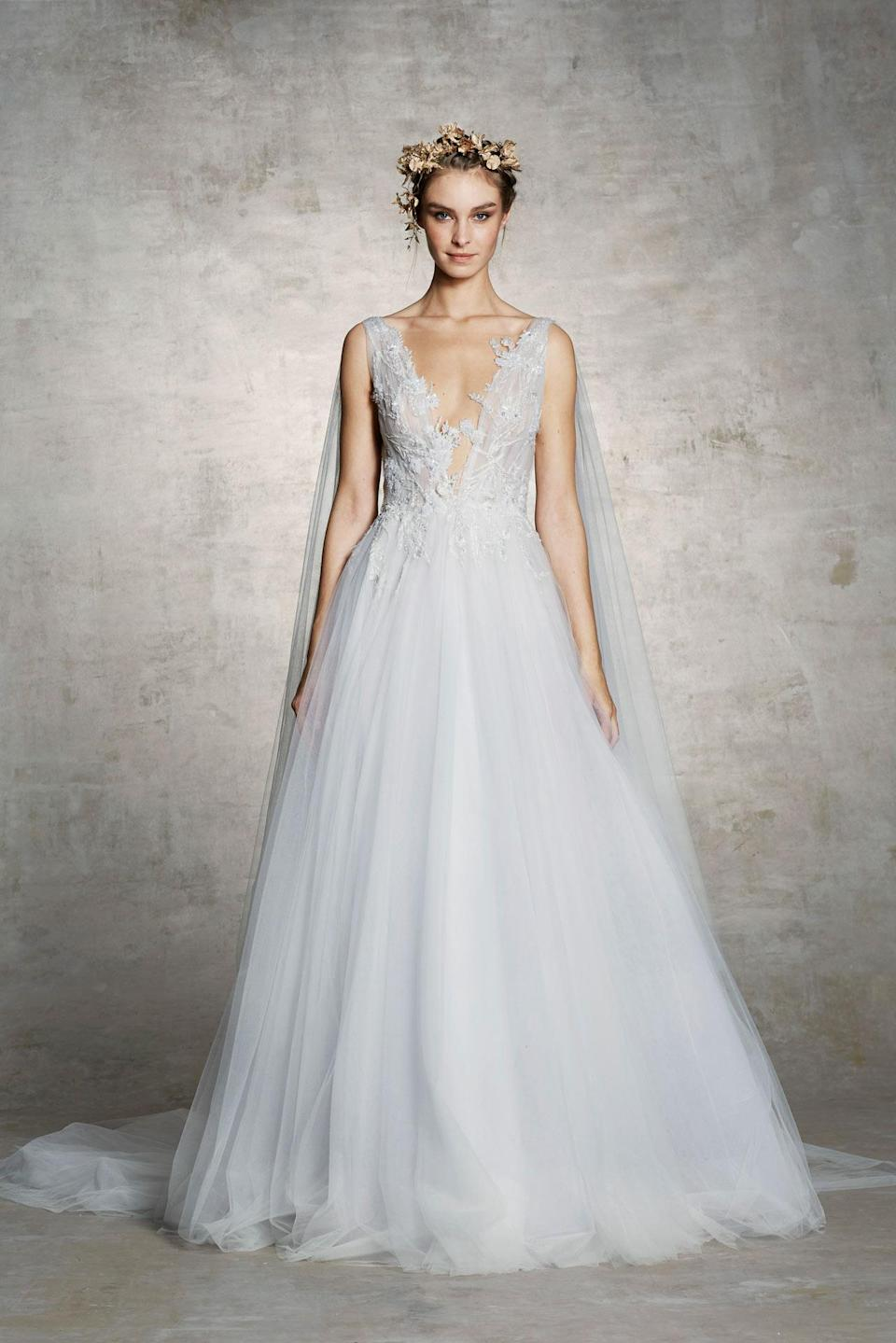 <p>Tulle dress with long tulle cape. (Photo: Courtesy of Marchesa) </p>