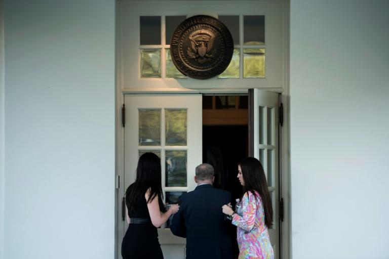 White House Press Secretary Sean Spicer walks back to the West Wing after apologising about a comparison he made between Syria's President Bashar al-Assad and Hitler