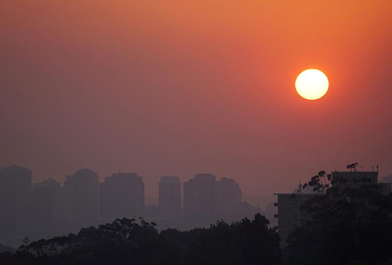 High-rise buildings seen through smoke from bushfires during sunset in Sydney. (Photo: REUTERS)