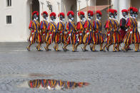 Vatican Swiss Guards wearing masks to curb the spread of COVID-19 march as they leave the St. Damaso courtyard after the visit of Spain's Prime Minister Pedro Sanchez to Pope Francis, at the Vatican, Saturday, Oct. 24, 2020. (AP Photo/Alessandra Tarantino)