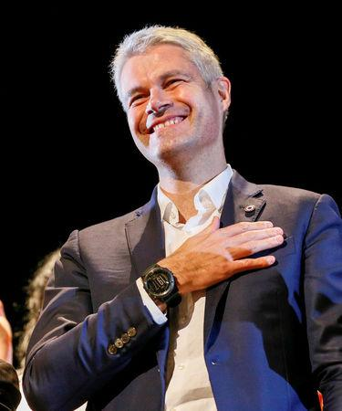 "FILE PHOTO: Laurent Wauquiez, the front-runner for the leadership of French conservative party ""Les Republicains"" (The Republicans) attends a political rally in Saint-Priest, near Lyon, France, December 7, 2017.   REUTERS/Robert Pratta/File Photo"
