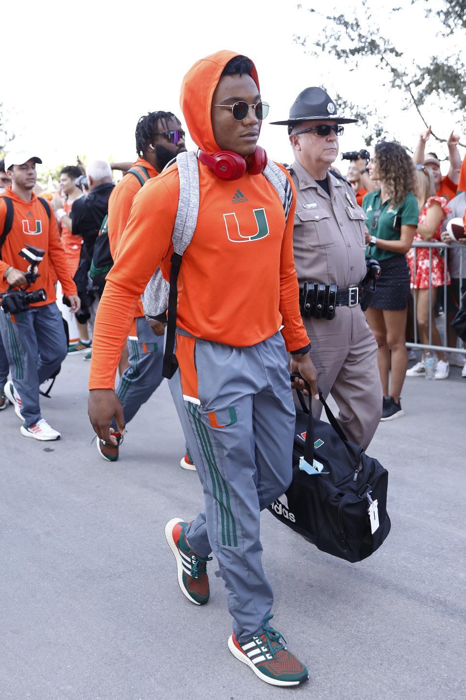 Miami Hurricanes quarterback D'Eriq King (1) arrives on the Hurricane Walk before the start of an NCAA college football game against Michigan State, Saturday, Sept. 18, 2021, in Miami Gardens, Fla. (AP Photo/Michael Reaves)