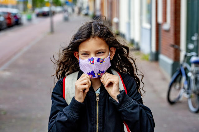 A child wears a mask on her way to school in Rotterdam. (Getty Images)