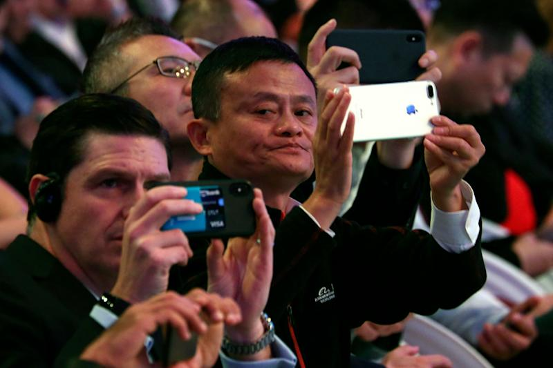 Jack Ma, Alibaba's leader uses his smart phone to record the start of Alibabas 11.11 The Global Shopping Festival, which was held in Shanghai, China, early Sunday, November 11, 2018. What started ten years ago as a day of online campaign with $ 7.8 million in sales, has grown into the world's largest e-commerce event that generates USD 25,3billion in 2017. (AP Photo / Ng Han Guan)