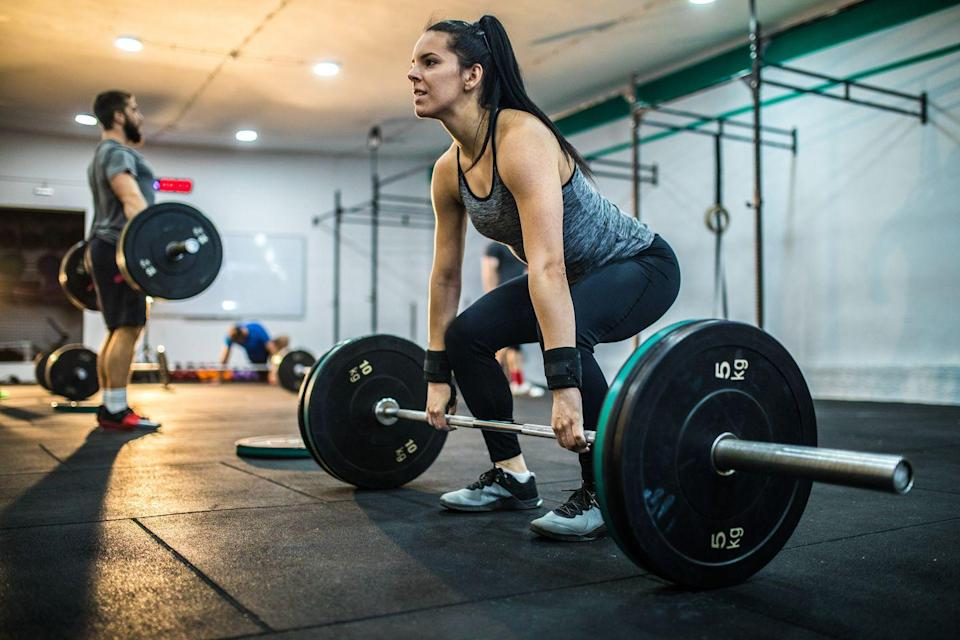 """<p>Whether you're lifting weights in the gym or in your garage (current situ), the advice is the same. </p><p>As most experts have agreed, there will be a degree of individual preference as to how much to eat in a pre-workout meal, and PT <a href=""""https://www.womenshealthmag.com/uk/fitness/workouts/a30560221/bodyweight-strength-training"""" rel=""""nofollow noopener"""" target=""""_blank"""" data-ylk=""""slk:Laura Hoggins"""" class=""""link rapid-noclick-resp"""">Laura Hoggins</a> thinks no differently. 'How close to the start of your strength training you need to eat varies from person to person', she says.<br><br>She personally eats a moderate serving of protein from an easy to digest source, some simple carbohydrates that will digest quickly and little to no fibrous veg or fruit.<br><br>Why? Well, 'the protein helps satiate you so you don't feel hungry during sessions whilst also promoting strength and muscle repair, and the simple carbs will fuel your session, so you feel like you have energy to give the whole way through. Plus, the removal of the fibrous veg or fruit is purely to make sure the digestion of the food is quick to slow you down during your session,' she explains.<br><br>A top tip: sometimes, when Laura trains early in the morning, she makes sure to eat a little more at dinner the night before to make sure the fuel is there to train.<br></p>"""