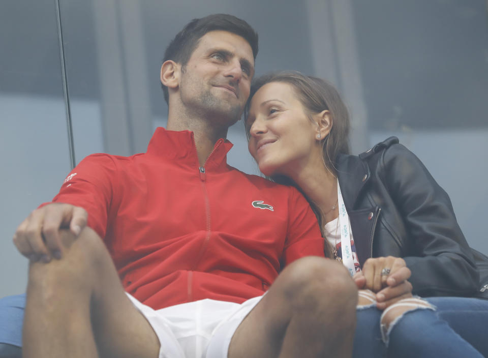 BELGRADE, SERBIA - JUNE 12: Novak Djokovic (L) of Serbia relaxes with his wife Jelena Djokovic (R) after the exhibition doubles match of the Adria Tour charity exhibition hosted by Novak Djokovic, on June 12, 2020 in Belgrade, Serbia. (Photo by Srdjan Stevanovic/Getty Images)