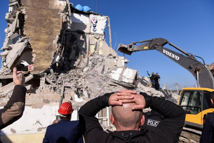 Rescue workers remove debris from a collapsed building in  Thumane, northwest of capital Tirana, after an earthquake hit Albania, on November 26, 2019. (Photo: Armend NimaniI/AFP via Getty Images)