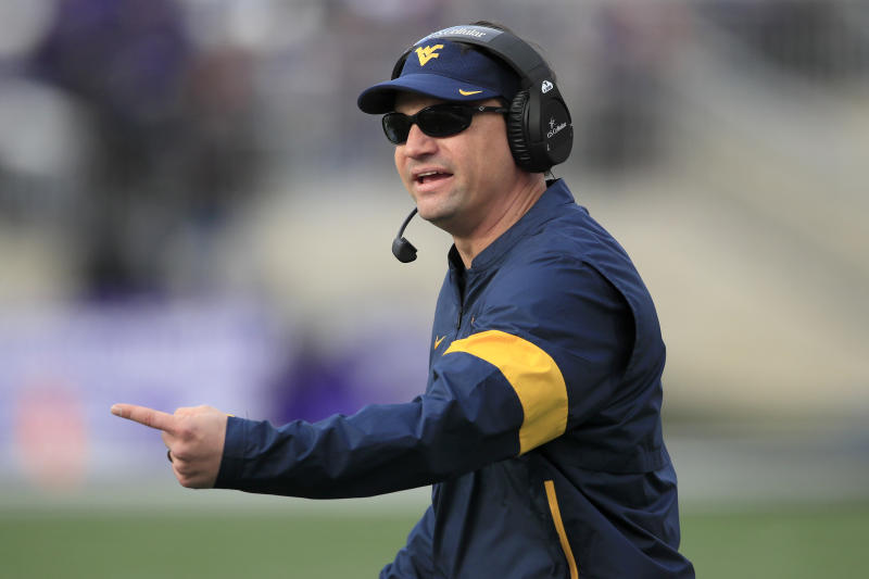 West Virginia head coach Neal Brown questions an official during the first half of an NCAA college football game against Kansas State in Manhattan, Kan., Saturday, Nov. 16, 2019. (AP Photo/Orlin Wagner)
