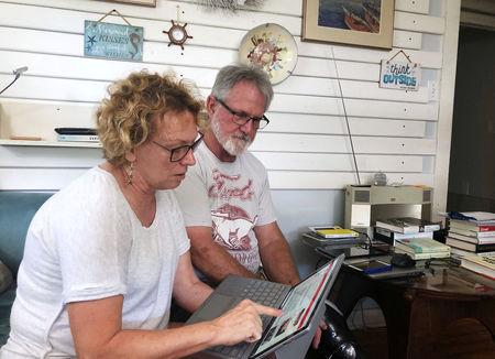 Eileen O'Brien, 65, and Michael O'Brien, 62, read the redacted report by U.S. Special Counsel Robert Mueller on Russian interference in the 2016 U.S. presidential election, at their home in Clearwater, Florida, U.S., April 18, 2019.    REUTERS/Letitia Stein