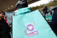 Deliveroo riders demonstrate to push for improved working conditions, in London