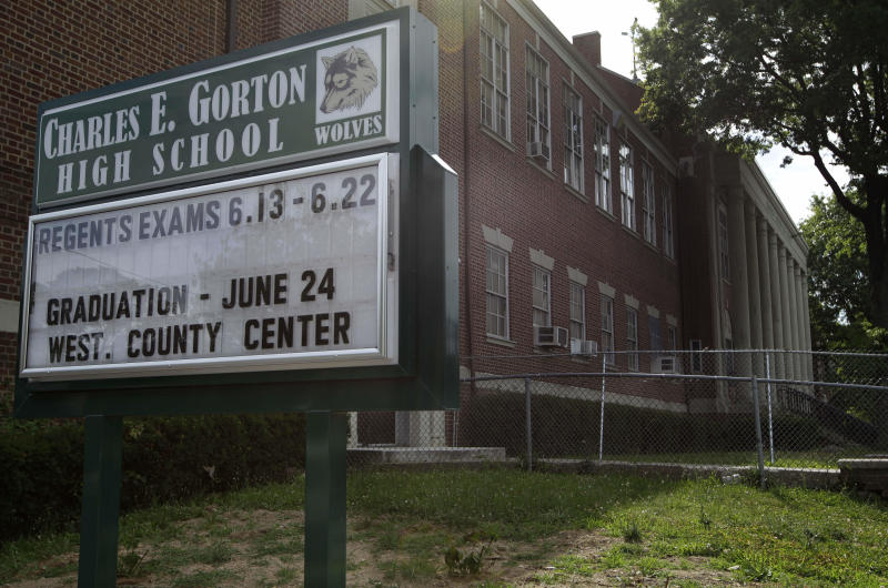 This Thursday, July 5, 2012 photo shows the exterior of the 88 year-old Charles E. Gorton High School in Yonkers, N.Y.  The Yonkers school district is looking for investors to pay for a $1.7 billion overhaul of dozens of schools, including Gorton, built in 1924 and 43% over-enrolled, according to school district officials.  To replace the building would cost $128 million and to overhaul it with repairs would cost $428 million, according to John Carr, who heads up the Yonkers Public Schools Facilities division. Across the country, innovative deals are now being discussed that would put essential pieces of public infrastructure in the hands of global investment firms, the latest effort to cope with a lingering fiscal crisis that has left some communities unable to pay for their needs. (AP Photo/Kathy Willens)