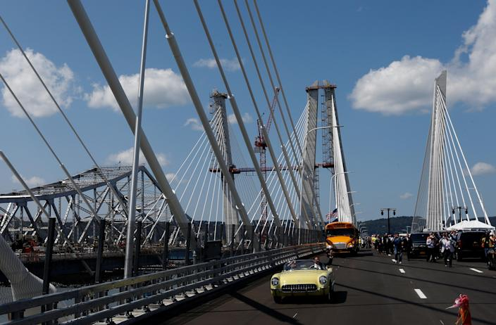 """New York Governor Andrew Cuomo drives a 1955 Chevrolet Corvette with World War II veteran Armando """"Chick"""" Gallela, during a dedication ceremony for the new Governor Mario M. Cuomo Bridge that is to replace the current Tappan Zee Bridge over the Hudson River in Tarrytown, New York, U.S., August 24, 2017. REUTERS/Mike Segar"""
