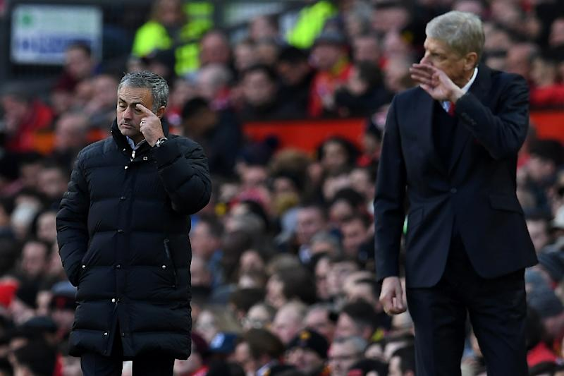Manchester United's manager Jose Mourinho and Arsenal's manager Arsene Wenger watch their players from the touchline during the match on November 19, 2016
