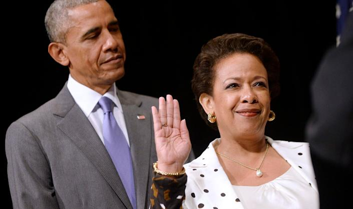 Attorney General Loretta Lynch (R) is sworn in during a formal investiture ceremony as U.S. President Barack Obama looks on at the Warner Theatre June 17, 2015 in Washington, DC. Lynch was officially sworn in by Vice President Joe Biden as the 83rd Attorney General of the United States on April 27, 2015. She is the first African-American woman to serve in the position. (Photo by Olivier Douliery – Pool/Getty Images)