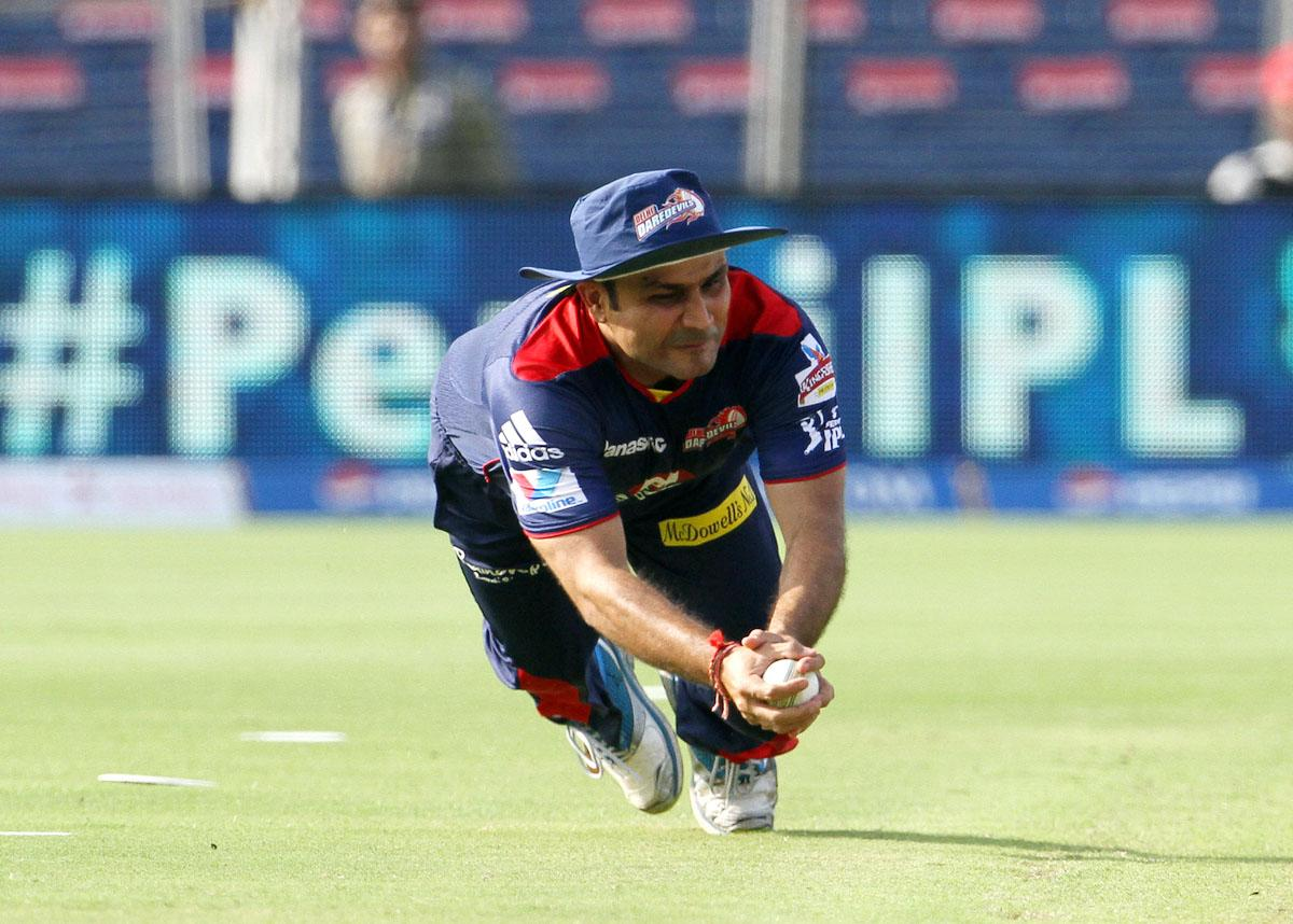 Delhi Daredevils player Virender Sehwag takes the catch of Pune Warriors captain Aaron Finch during match 71 of the Pepsi Indian Premier League ( IPL) 2013  between The Pune Warriors India and the Delhi Daredevils held at the Subrata Roy Sahara Stadium, Pune on the 19th May 2013. (BCCI)