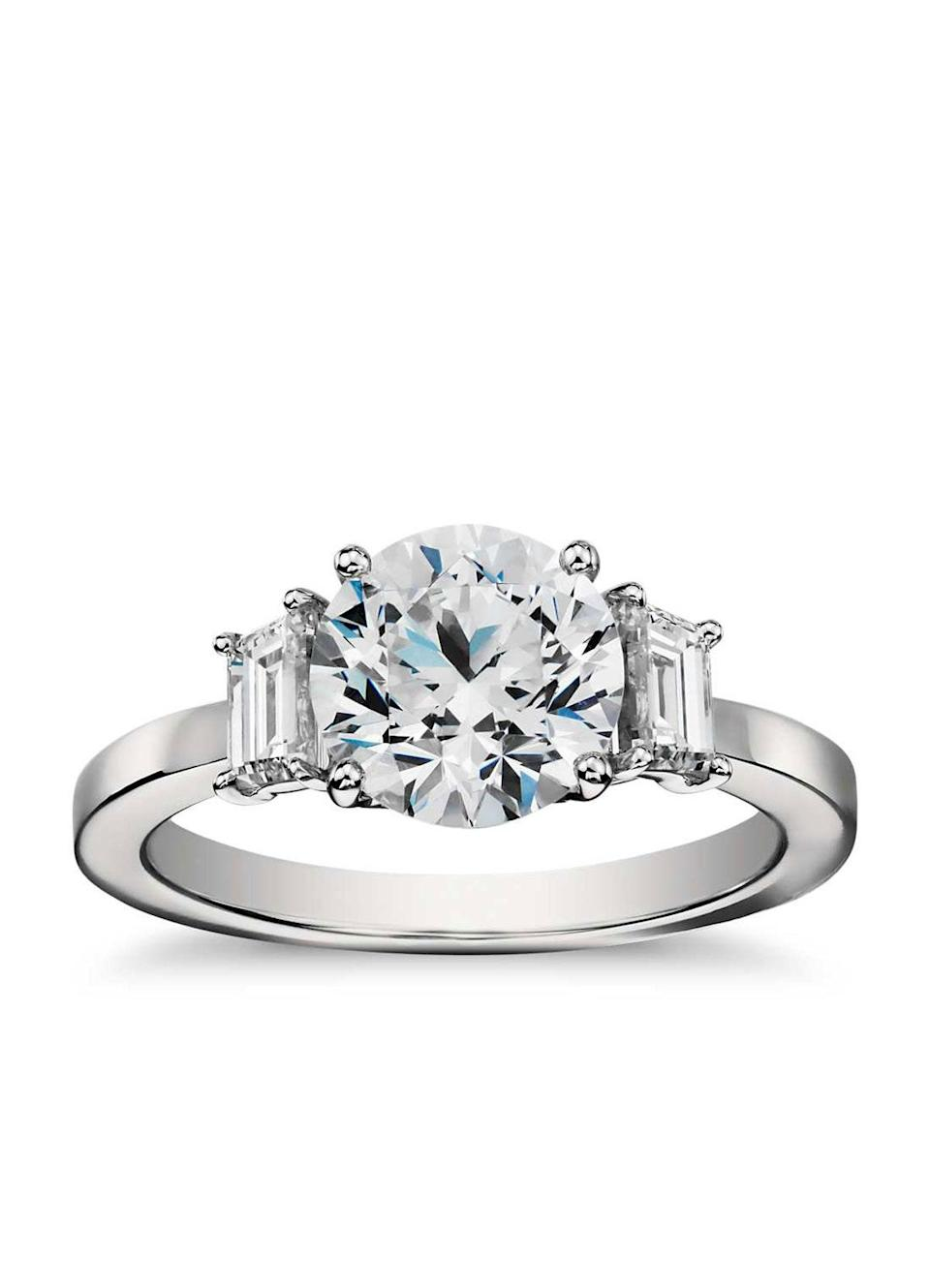 """Trapezoid stones can come in a variety of settings; the most popular are front and center by themselves (a.k.a. solitaire), or as part of a trio (à la Meghan Markle's ring). Engagement rings with pavé detailing, specifically, have seen a double-digit growth on Blue Nile. $4990, Blue Nile. <a href=""""https://www.bluenile.com/build-your-own-ring/step-cut-trapeziod-diamond-engagement-ring-platinum_27486?elem=title&track=product"""" rel=""""nofollow noopener"""" target=""""_blank"""" data-ylk=""""slk:Get it now!"""" class=""""link rapid-noclick-resp"""">Get it now!</a>"""