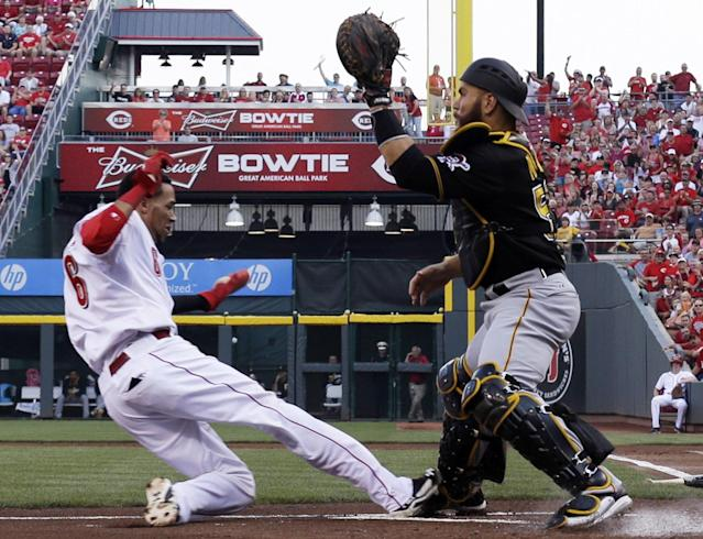 Cincinnati Reds' Billy Hamilton (6) is safe at home as Pittsburgh Pirates catcher Russell Martin waits for the ball in the first inning of a baseball game, Friday, July 11, 2014, in Cincinnati. Hamilton scored on a hit by Zack Cozart. (AP Photo/Al Behrman)