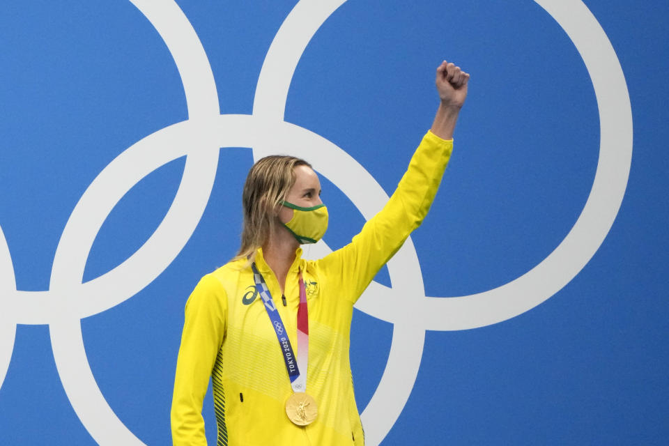 Emma Mckeon, of Australia, celebrates after winning the gold medal in the women's 100-meter freestyle final at the 2020 Summer Olympics, Friday, July 30, 2021, in Tokyo, Japan. (AP Photo/David Goldman)