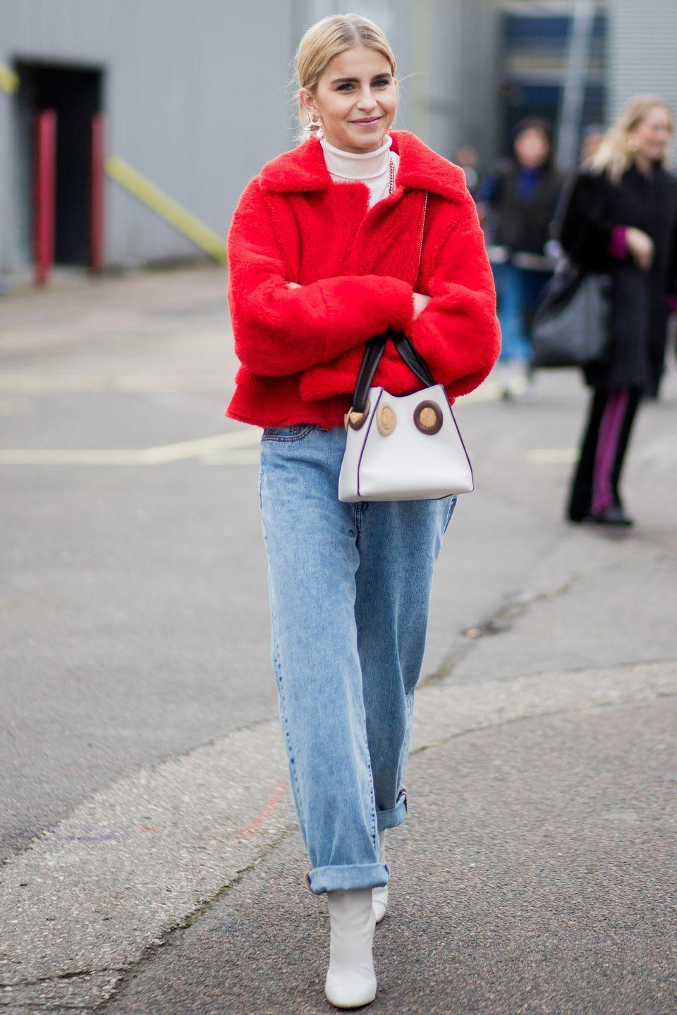 <p>Roll up your jeans to show off the boot, rather than wearing them to the ground.</p>