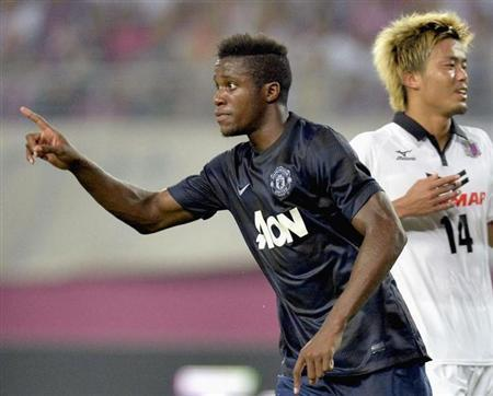 Manchester United's Wilfried Zaha (L) celebrates after scoring during their friendly soccer match against Cerezo Osaka in Osaka, western Japan, in this photo taken by Kyodo July 26, 2013. REUTERS/Kyodo