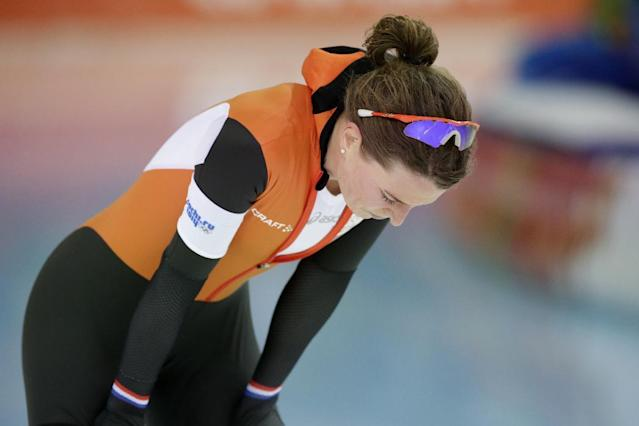 Silver medallist Ireen Wust of the Netherlands catches her breath after competing in the women's 5,000-meter speedskating race at the Adler Arena Skating Center during the 2014 Winter Olympics in Sochi, Russia, Wednesday, Feb. 19, 2014. (AP Photo/Matt Dunham)