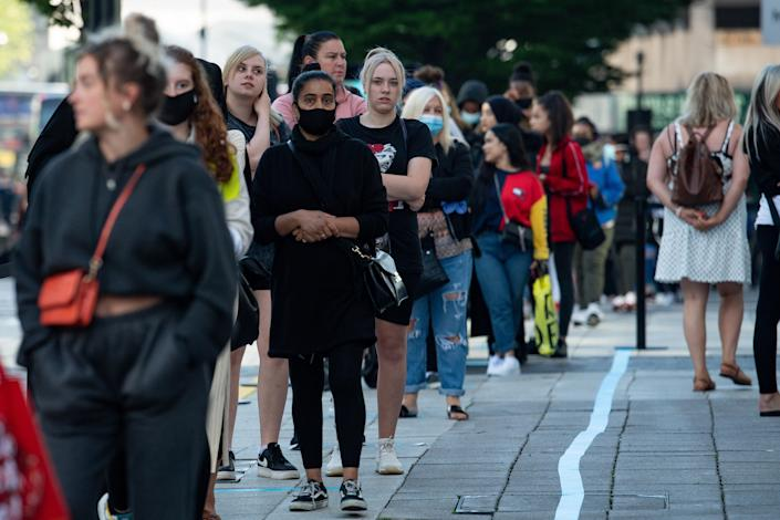 Shoppers queueing outside Primark in Birmingham as non-essential shops in England opened their doors to customers for the first time since coronavirus lockdown restrictions were imposed in March. (PA)