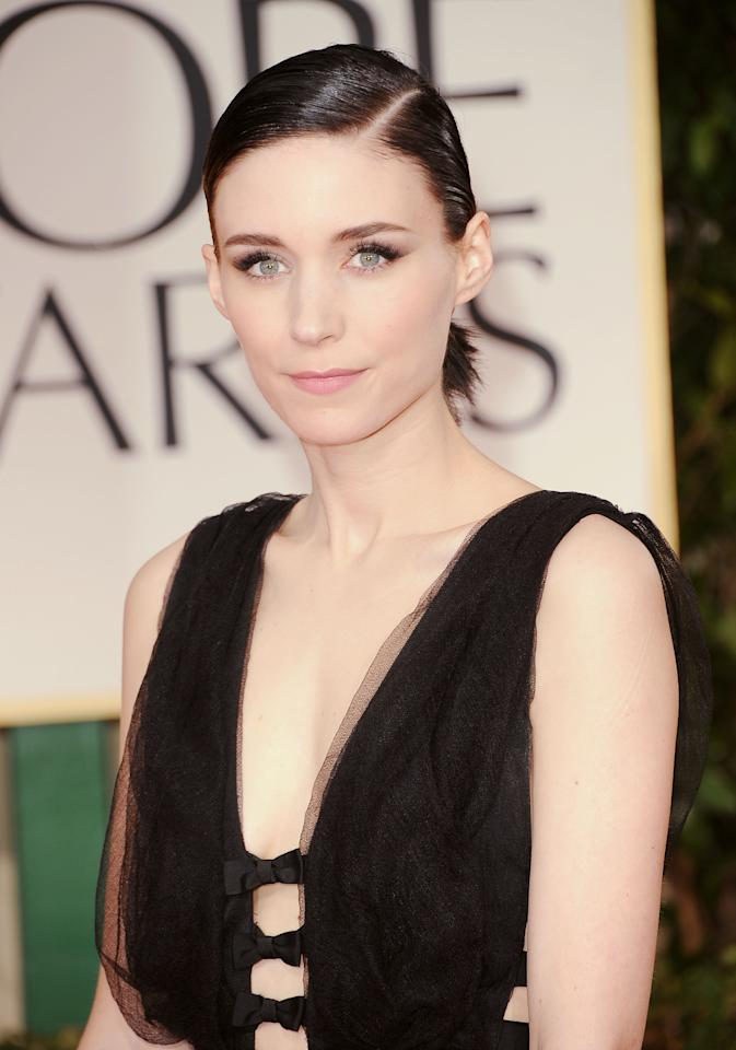 "Rooney Mara went Goth for Globes. The ""Girl With the Dragon Tattoo"" star kept her hair (which is growing out now) in a minimal ponytail and wore all black Nina Ricci. When E! asked her to explain her style, she said ""I have no idea. It is comfortable."""