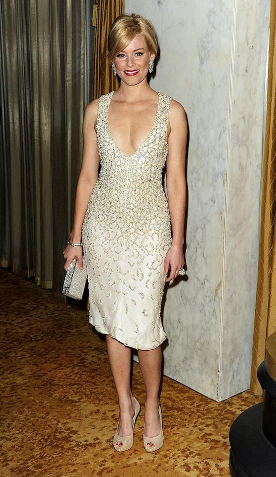 "Back in Beverly Hills, Elizabeth Banks rocked a simple yet seriously chic dress, diamond accents, and nude peep-toes at a pre-Oscars bash. Kevin Winter/<a href=""http://www.gettyimages.com/"" target=""new"">GettyImages.com</a> - February 20, 2010"