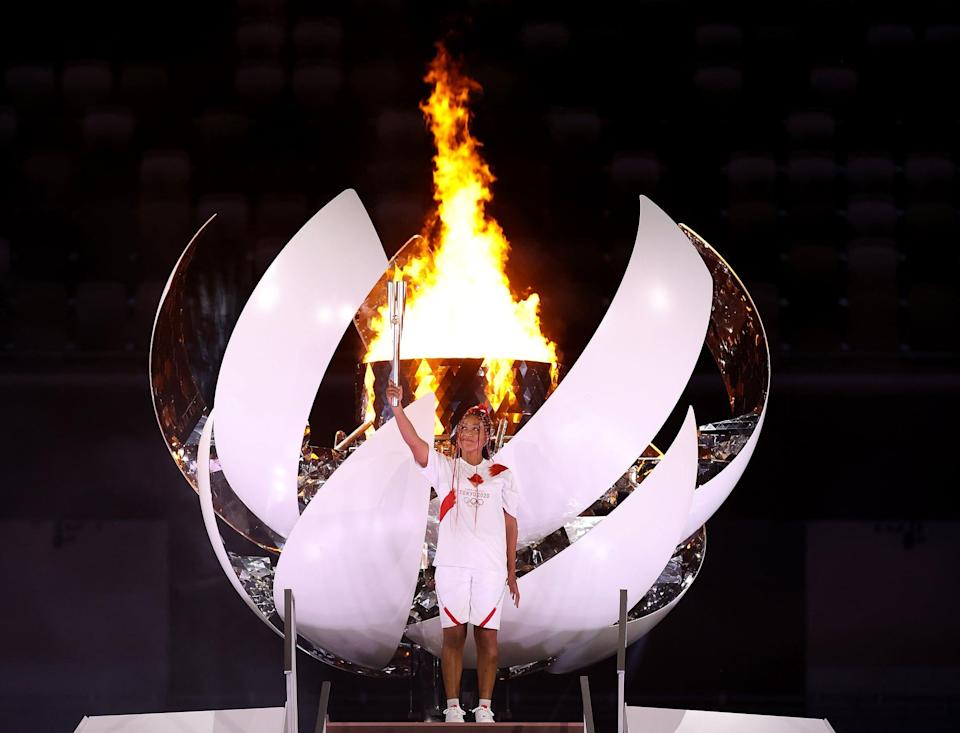 """<p>Viewers around the world cheered when it was finally revealed that <a href=""""https://www.popsugar.com/fitness/naomi-osaka-lights-olympic-cauldron-opening-ceremony-2021-48431552"""" class=""""link rapid-noclick-resp"""" rel=""""nofollow noopener"""" target=""""_blank"""" data-ylk=""""slk:four-time Grand Slam champion Naomi Osaka"""">four-time Grand Slam champion Naomi Osaka</a> would light the Olympic cauldron in Tokyo. Get the party started this <a class=""""link rapid-noclick-resp"""" href=""""https://www.popsugar.co.uk/Halloween"""" rel=""""nofollow noopener"""" target=""""_blank"""" data-ylk=""""slk:Halloween"""">Halloween</a> by drawing inspiration from her opening-ceremony look, complete with a homemade or inflatable torch.</p> <ul> <li><span>Nike Dri-FIT Academy Soccer Top</span> ($25)</li> <li><span>Nike Dri-FIT Academy Knit Soccer Shorts</span> ($22)</li> <li><span>Gejoy 3-Piece Inflatable Torch</span> ($9, originally $13)</li> </ul>"""