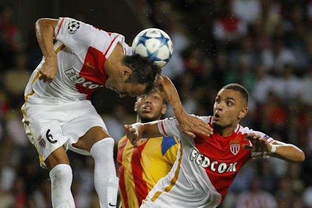 Monaco's Portuguese defender Ricardo Carvalho heads the ball during the UEFA Champions League playoff football match between AS Monaco FC vs Valencia CF, at the Louis II Stadium, in Monaco, on August 25, 2015