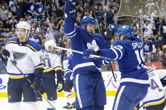 oronto Maple Leafs center Frederik Gauthier (33) celebrates with center Jason Spezza (19) after scoring his team's first goal as St. Louis Blues left wing Zach Sanford (12) looks on during the second period of an NHL hockey game, Monday, Oct. 7, 2019 in Toronto. (Chris Young/The Canadian Press via AP)