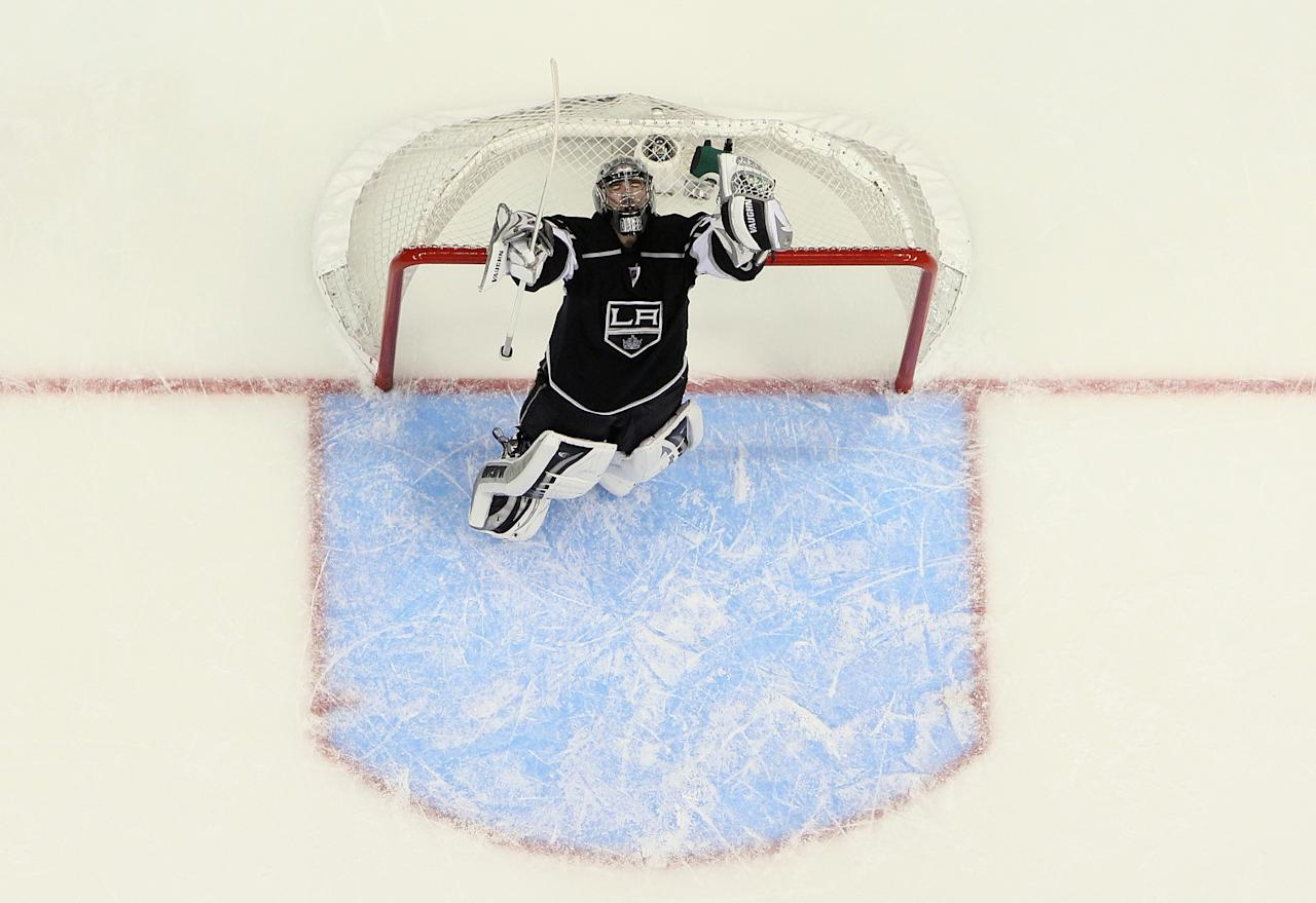 LOS ANGELES, CA - MAY 28: Goaltender Jonathan Quick #32 of the Los Angeles Kings celebrates his teams 2-1 victory over the San Jose Sharks in game Seven of the Western Conference Semifinals during the 2013 NHL Stanley Cup Playoffs at Staples Center on May 28, 2013 in Los Angeles, California. (Photo by Jeff Gross/Getty Images)