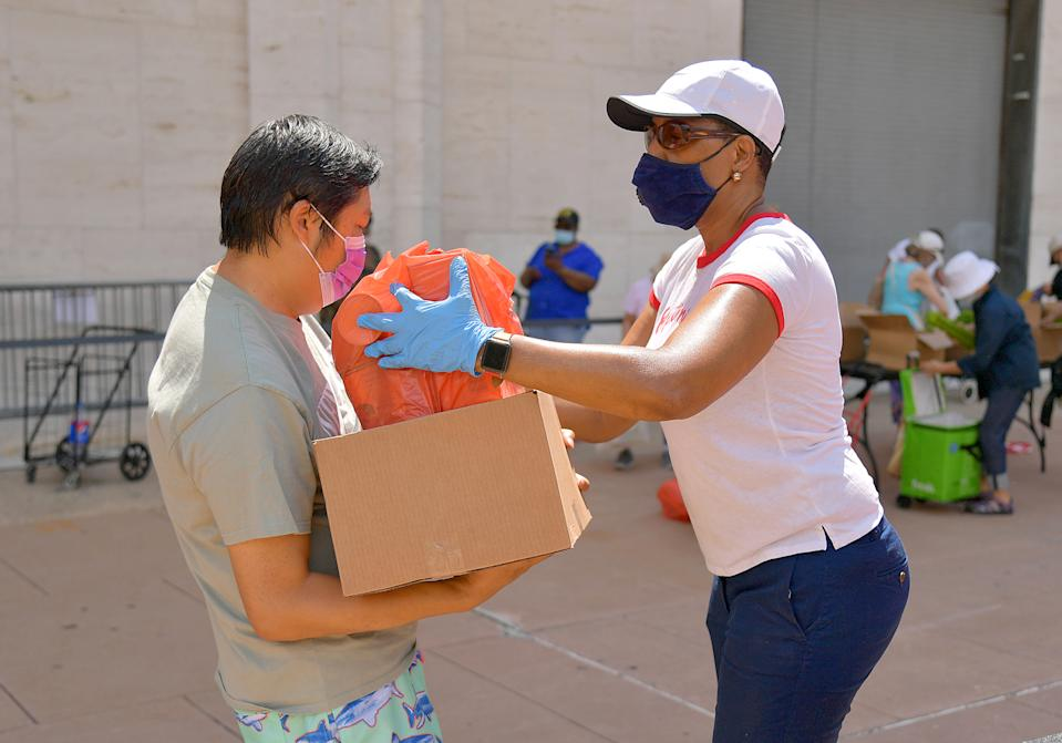 NEW YORK, NEW YORK - JULY 29: New Yorkers in need receive free produce, dry goods, and meat at a Food Bank For New York City distribution event at Lincoln Center on July 29, 2020 in New York City. In addition to unemployment and homelessness, millions of Americans face food insecurity as a result of the economic downturn caused by the coronavirus pandemic (Photo by Michael Loccisano/Getty Images for Food Bank For New York City)