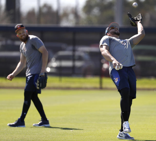 Houston Astros center fielder George Springer catches a ball as he ran some drills during spring baseball training, Friday, Feb. 16, 2018, in West Palm Beach, Fla. (Karen Warren/Houston Chronicle via AP)